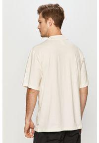 Kremowy t-shirt Russell Athletic na co dzień, z nadrukiem