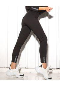 CUORI e PICCHE - Czarne legginsy Cart. Stan: podwyższony. Kolor: czarny. Materiał: bawełna