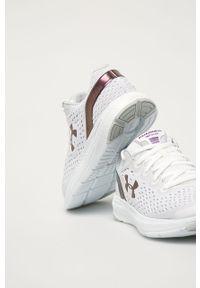 Białe buty sportowe Under Armour na obcasie, na sznurówki, z cholewką