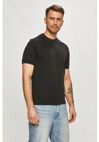 Calvin Klein Jeans - T-shirt. Kolor: czarny. Materiał: bawełna. Wzór: nadruk
