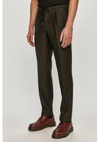 Hugo - Spodnie. Kolor: zielony