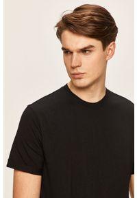 Czarny t-shirt Calvin Klein Jeans z okrągłym kołnierzem, z aplikacjami, casualowy, na co dzień