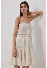 Superdry - Sukienka. Kolor: beżowy. Materiał: tkanina. Długość rękawa: na ramiączkach. Wzór: gładki. Typ sukienki: rozkloszowane