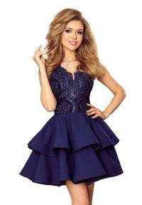 Niebieska sukienka Numoco w koronkowe wzory, na imprezę