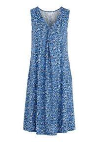 Cellbes Wzorzysta, rozszerzana sukienka z dżerseju niebieski w kwiaty female niebieski/ze wzorem 62/64. Typ kołnierza: dekolt w serek. Kolor: niebieski. Materiał: jersey. Długość rękawa: bez rękawów. Wzór: kwiaty. Typ sukienki: kopertowe
