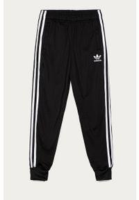 Czarne spodnie dresowe adidas Originals z aplikacjami, casualowe