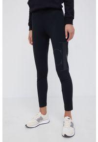 Calvin Klein Jeans - Legginsy. Kolor: czarny. Materiał: bawełna, dzianina. Wzór: nadruk