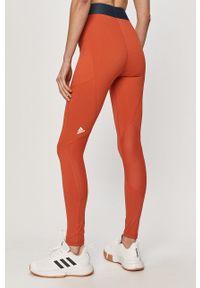 adidas Performance - Legginsy. Kolor: pomarańczowy. Materiał: dzianina