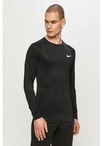 Nike - Longsleeve. Kolor: czarny. Materiał: tkanina, dzianina, skóra, włókno. Długość rękawa: długi rękaw