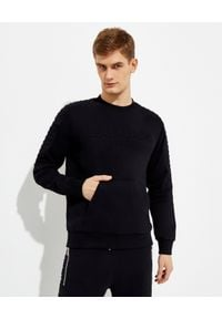 Balmain - BALMAIN - Czarna bluza z logo. Kolor: czarny. Materiał: bawełna. Długość rękawa: długi rękaw. Długość: długie. Wzór: aplikacja