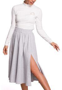 BE - Rozkloszowana spódnica midi z rozcięciem z boku. Materiał: bawełna, dzianina, materiał, elastan. Styl: sportowy