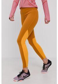 Reebok - Legginsy. Kolor: pomarańczowy. Materiał: dzianina, skóra