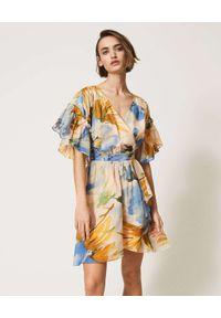 TwinSet - TWINSET - Sukienka mini z kwiatowym wzorem Hamal. Typ kołnierza: dekolt w kształcie V. Kolor: niebieski. Materiał: materiał. Wzór: kwiaty. Długość: mini