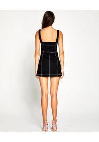 ALICE MCCALL - Czarna sukienka Rock With You. Kolor: czarny. Materiał: materiał. Sezon: wiosna. Typ sukienki: dopasowane. Styl: rockowy. Długość: mini