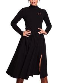 BE - Rozkloszowana spódnica midi z rozcięciem z boku. Materiał: elastan, dzianina, materiał, bawełna. Styl: sportowy