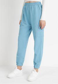 Born2be - Jasnoniebieskie Spodnie Dresowe Xirys. Stan: podwyższony. Kolor: niebieski. Materiał: dresówka. Długość: długie. Wzór: jednolity, aplikacja