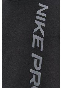 Nike - T-shirt. Okazja: na co dzień. Kolor: szary. Materiał: tkanina, dzianina, skóra, włókno. Wzór: nadruk. Styl: casual
