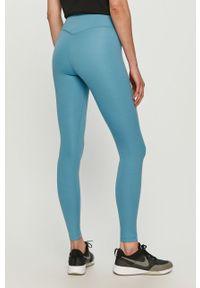 Nike - Legginsy. Stan: podwyższony. Kolor: niebieski. Materiał: tkanina, dzianina, poliester, elastan, włókno, skóra. Wzór: gładki #3