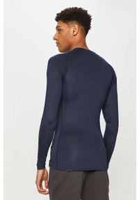 Nike - Longsleeve. Kolor: niebieski. Materiał: tkanina, dzianina, skóra, włókno. Długość rękawa: długi rękaw