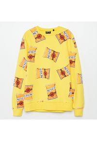 Żółta bluza Cropp z nadrukiem