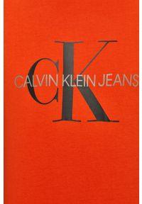 Pomarańczowy t-shirt Calvin Klein Jeans na co dzień, casualowy, z nadrukiem