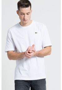 Lacoste - T-shirt. Okazja: na co dzień. Kolor: biały. Materiał: dzianina. Wzór: gładki. Styl: casual