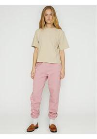 ROTATE Spodnie dresowe Mimi RT472 Różowy Loose Fit. Kolor: różowy. Materiał: dresówka
