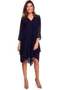 MOE - Granatowa Asymetryczna Sukienka Dwuwarstwowa z Dzwonkowym Rękawem. Kolor: niebieski. Materiał: poliester, elastan. Typ sukienki: asymetryczne