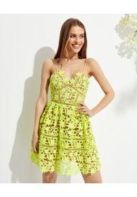 SELF PORTRAIT - Neonowa sukienka mini z koronki. Kolor: zielony. Materiał: koronka. Długość rękawa: na ramiączkach. Wzór: koronka. Typ sukienki: dopasowane, rozkloszowane. Długość: mini
