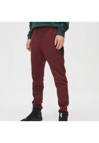 Czerwone spodnie Cropp z aplikacjami