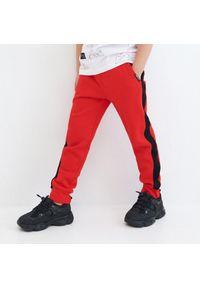 Czerwone spodnie Reserved