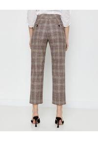 CAPPELLINI - Brązowe spodnie w kratę. Okazja: na spotkanie biznesowe, do pracy. Stan: podwyższony. Kolor: brązowy. Materiał: materiał. Styl: elegancki, biznesowy