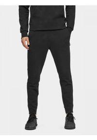 Czarne spodnie dresowe outhorn