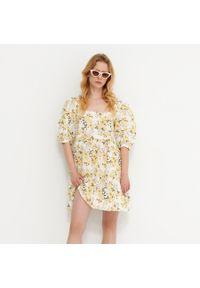 House - Sukienka w kwiaty z domieszką lnu - Żółty. Kolor: żółty. Materiał: len. Wzór: kwiaty