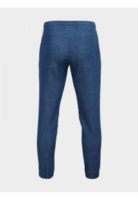 Niebieskie spodnie dresowe outhorn melanż