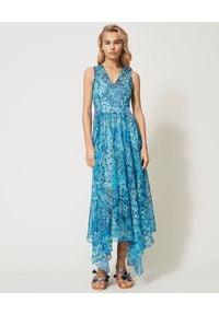 TwinSet - TWINSET - Niebieska sukienka z asymetrycznym dołem. Kolor: niebieski. Wzór: kwiaty, nadruk. Typ sukienki: asymetryczne. Długość: maxi