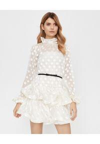 ZIMMERMANN - Biała sukienka w grochy. Okazja: na co dzień. Kolor: biały. Materiał: jedwab. Długość rękawa: długi rękaw. Wzór: grochy. Styl: casual