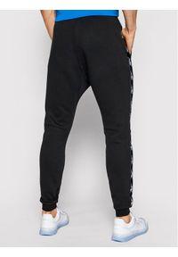 Reebok Spodnie dresowe Essentials Tape GQ4215 Czarny Regular Fit. Kolor: czarny. Materiał: dresówka #3