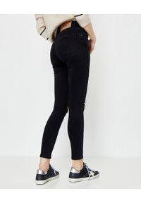 ONETEASPOON - Czarne jeansy High Waist Freebirds II. Stan: podwyższony. Kolor: czarny. Wzór: aplikacja. Styl: klasyczny, rockowy