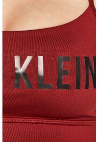 Brązowy biustonosz sportowy Calvin Klein Performance z odpinanymi ramiączkami, z nadrukiem