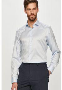 Hugo - Koszula bawełniana. Typ kołnierza: kołnierzyk włoski. Kolor: niebieski. Materiał: bawełna. Długość rękawa: długi rękaw. Długość: długie. Wzór: gładki