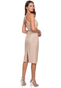 Makover - Dopasowana połyskująca sukienka zjawiskowy dekolt. Okazja: na imprezę. Typ sukienki: asymetryczne, ołówkowe. Długość: midi