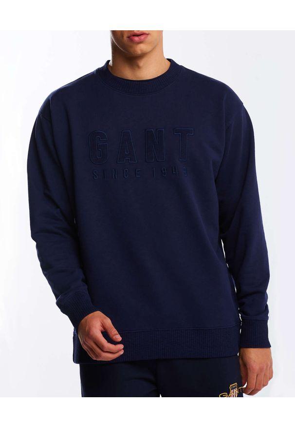 GANT - Granatowy bluza z monochromatycznym logo. Kolor: niebieski. Materiał: bawełna, dresówka. Długość rękawa: długi rękaw. Długość: długie