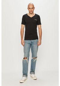 Calvin Klein Jeans - T-shirt. Okazja: na co dzień. Kolor: czarny. Materiał: dzianina. Wzór: gładki. Styl: casual