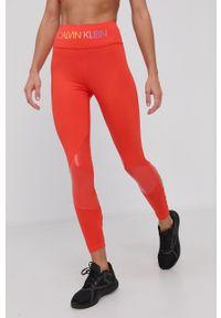 Calvin Klein Performance - Legginsy. Kolor: pomarańczowy. Materiał: dzianina. Wzór: nadruk