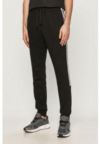Czarne spodnie dresowe Adidas z aplikacjami