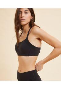 Czarny biustonosz sportowy Etam na fitness i siłownię