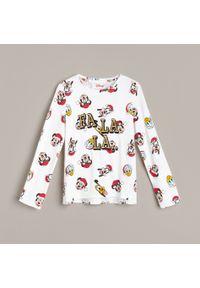 Kremowa bluzka z długim rękawem Reserved z motywem z bajki, wizytowa