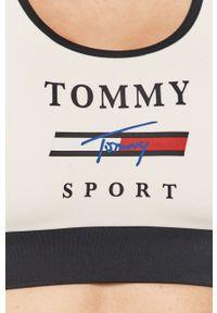 Biały biustonosz sportowy Tommy Sport z nadrukiem, z odpinanymi ramiączkami
