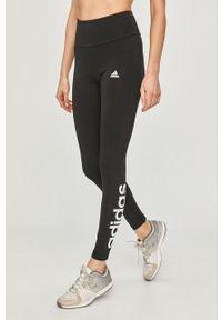 Adidas - adidas - Legginsy. Stan: podwyższony. Kolor: czarny. Materiał: dzianina. Wzór: nadruk
